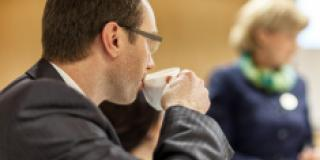 stock photo 58917102 businessman drinking coffee during conference